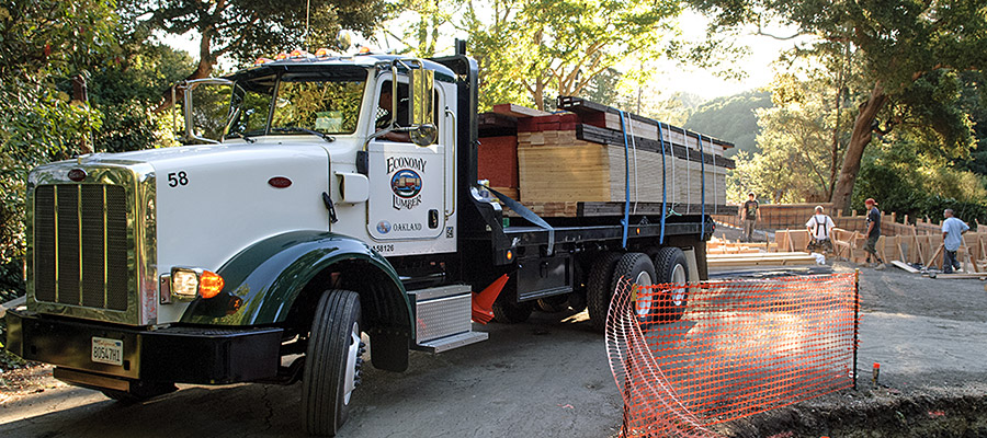 One of Economy Lumber Co. trucks delivering lumber to Orinda job site